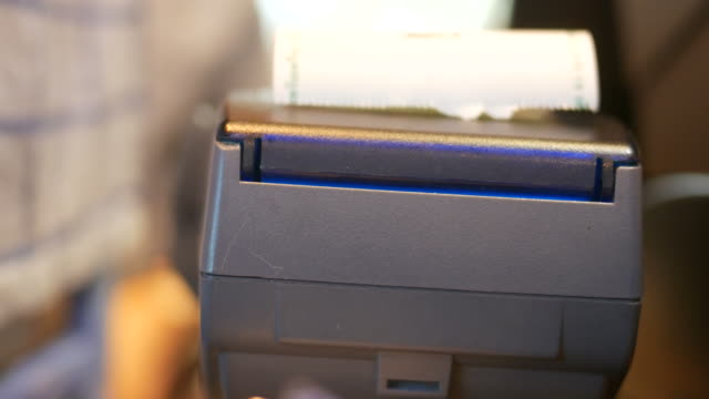 printing out a slip from credit card reader video