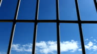 Prison bars and blue sky video