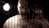 Prisoner in jail cell video