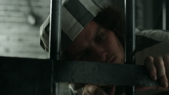 A prisoner trying to escape from his prison cell video