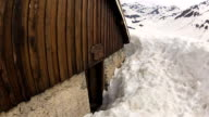 Private house under snow in Alps mountains video