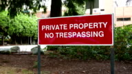 Private property no trespassing sign on road video