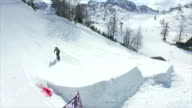 AERIAL: Pro snowboarder jumping big jump in snow park video
