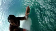 Pro surfer surfing big tube wave and falls video