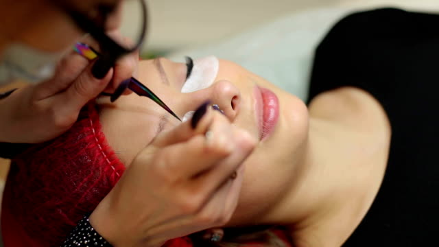 Procedure of eyelashes extension in salon. video
