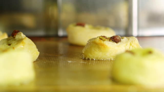 TIMELAPSE Process of baking appetizing, delicious pastry with raisins in the oven. Close-up video