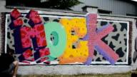Process of creation of graffiti, fence. video