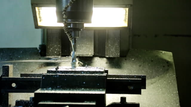 Process of drilling on the CNC machine and spraying of coolant video