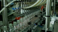 production of plastic bottles of mineral water lemonade. spilling water bottles. assembly-line production environmentally friendly production warehouse with the products video