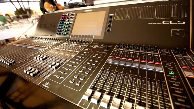 Professional audio console in a concert, sound mixer console during a concert, audio Mixer, control engineer, selective focus, audio mixer, shallow depth of field video
