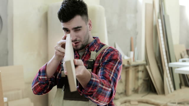 4K A professional carpenter touches the board from the particle board in the woodworking industry. video