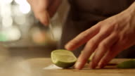 Professional Chef is Rapidly Slicing Lemon video