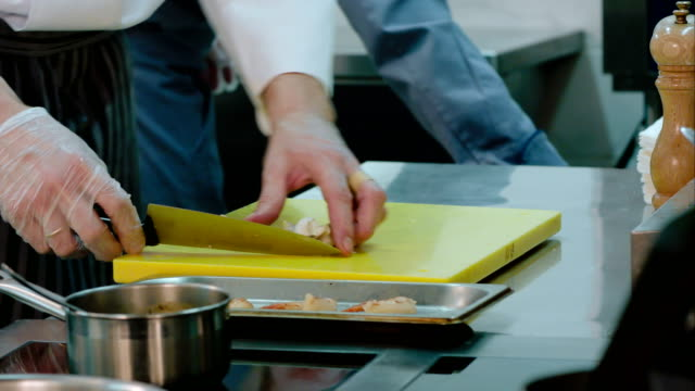 Professional chef's hands chopping mushrooms for shrimps video