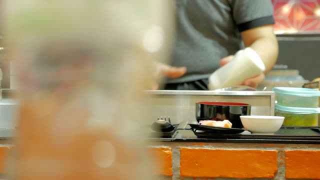 professional chefs preparing and cooking food in a kitchen. video