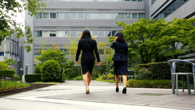 Professional Corporate Japanese Business Women Walking in an Office Courtyard video