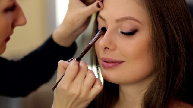 Professional Make-up artist doing model make-up. video
