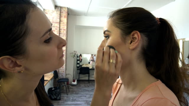 Professional make-up artist making face makeup art. Make up and fashion concept video