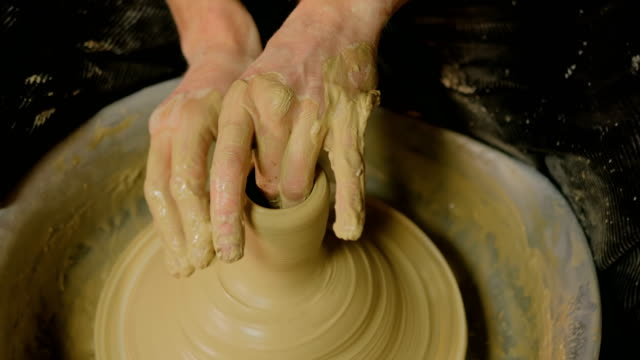 Professional male potter working in workshop video