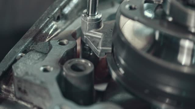 Professional mechanic repairing a CVT gearbox video