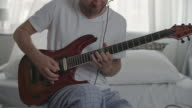 Professional Musician Playing the Guitar at Home video