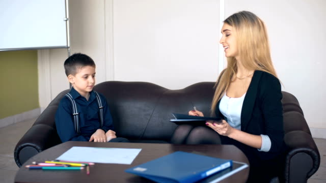 Professional psychologist talking to a schoolboy video