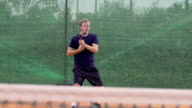 Professional Tennis Player Hits The Ball And Expresses Achievement video