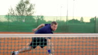 Professional Tennis Player Hits The Ball With Backhand Stroke video