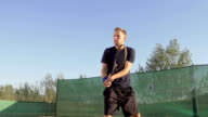 Professional Tennis Player Hitting The Ball With Backhand Stroke video