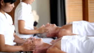 Professional Thai masseurs at work video