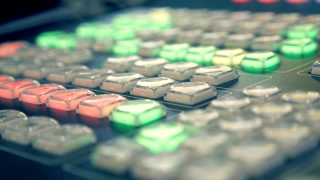 Professional video mixing console where the blinking buttons in different colors video