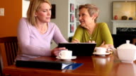 Professional with Digital Tablet Meets with Senior Woman video