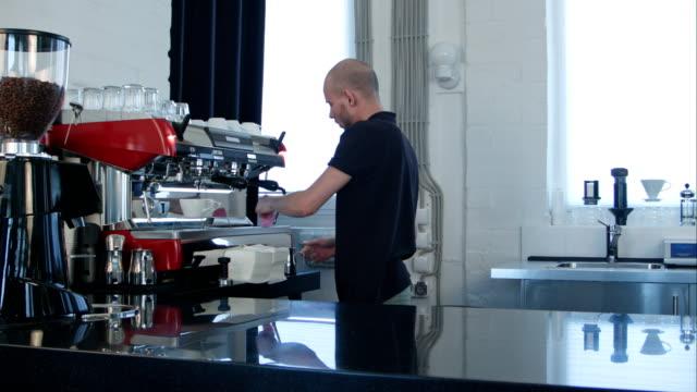 Professional work of barista, preparing milk for coffee video