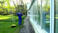 professional worker cleaning dirty windows with high pressure water jet video
