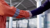 Professional worker shaking hands with businessman in a suit. Closeup view video