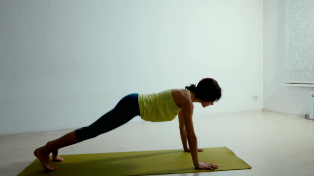 Professional yoga trainer conducting a lesson video