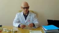 Professor Of Stomatology Preparing Exam Papers video