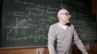 Professor talking to students video