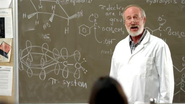 Professor teaching in a chemistry class video