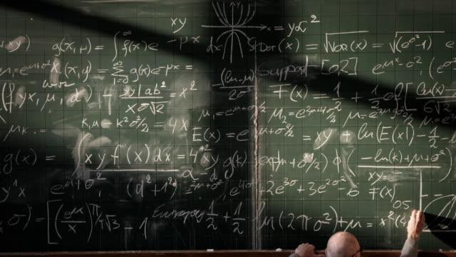 Professor writing on blackboard (timelapse) video