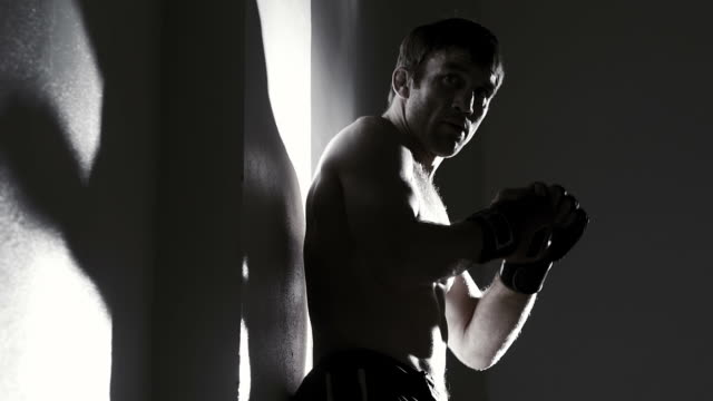 Profile of fighter shadow boxing video