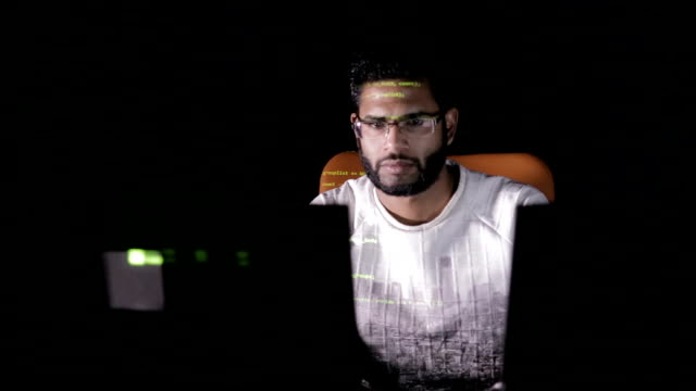 Programmer working on computer. It professional programming code on computer monitor video