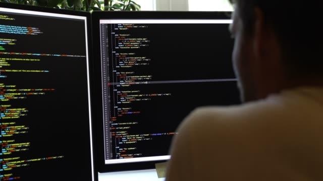 programmer writing programming code video