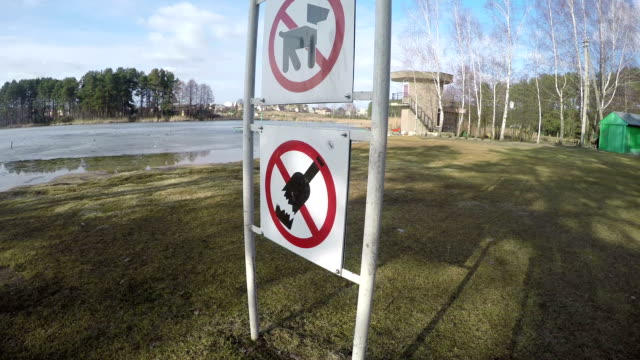 Prohibiting signs near lake. No dogs no alcohol no litter. video