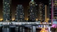 Promenade and canal in Dubai Marina timelapse at night, UAE video