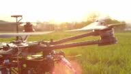 SLOW MOTION CLOSE-UP: Propellers start spinning on a drone video