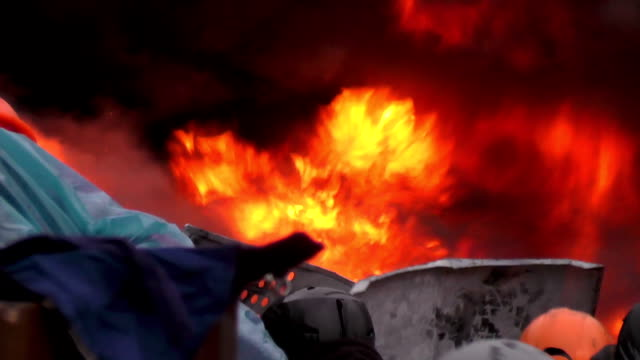 Protesters burned tires on the barricades. video