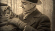 1937: Proud dad bundled up baby keeping warm in cold winter weather. video