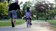 Proud Father Encourages Daughter Riding Her Bike video