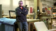 Proud owner of a woodworking business standing in his shop video