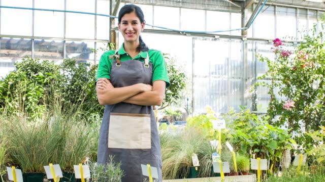 Proud woman working in garden center video